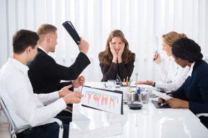 57364091 - upset businesswoman sitting with aggressive colleague in meeting