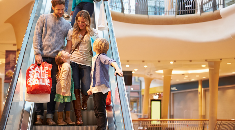 couple on escalator at mall