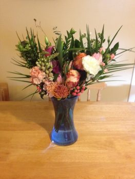Bouquet of flowers on kitchen table