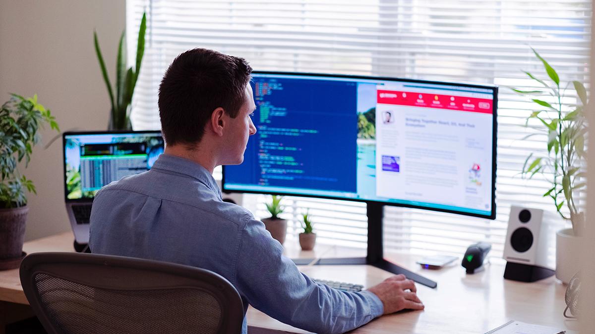 Businessman infront of a screen