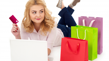 Woman with laptop credit card and shopping bags