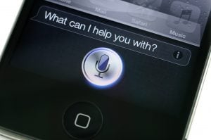 """Hong Kong, China - November 11, 2011: Apple iPhone 4s Siri. Siri is an intelligent personal assistant which works as an application for Apple's iOS."""