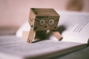 Danbo character reading book Photo by Lisa Fotios from Pexels