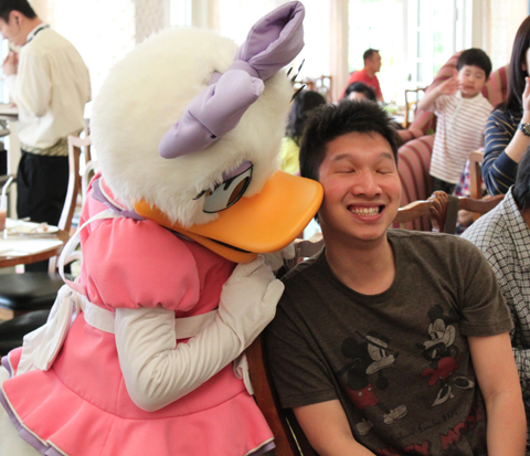 Figure 1 – Defining Moment: A Kiss from the Adorable Daisy Duck (photo courtesy of Tse Chun)