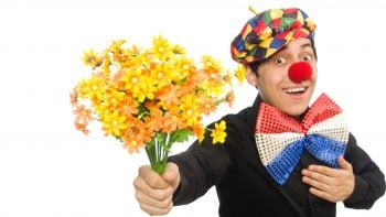 Smiling Clown Holding Flowers